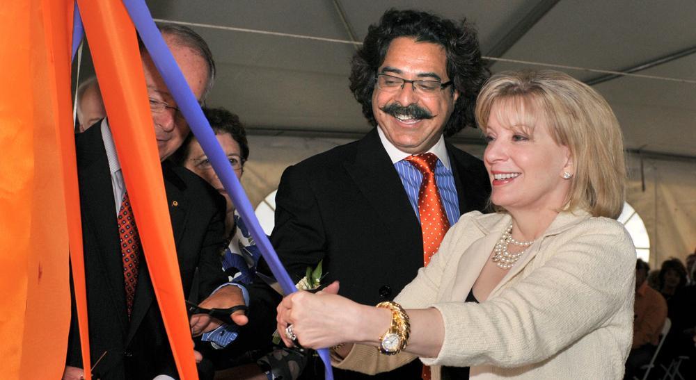 Ann Carlson Khan cutting ribbon