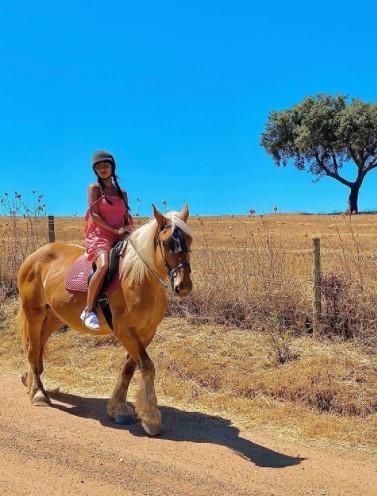 Nicole Scherzinger riding horse